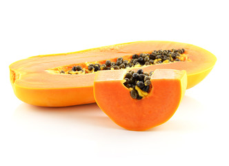 Half cut papaya fruits on white background