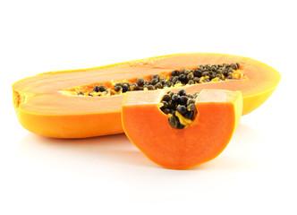 Half cut papaya fruits on white background