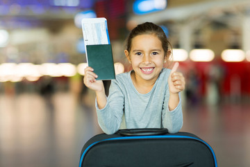 little girl giving thumb up at airport