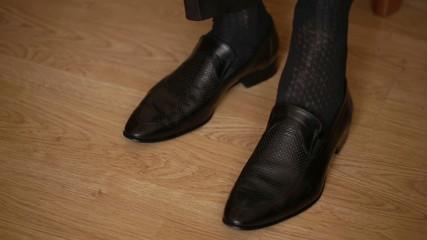 Man Puts On Tie, Watch, Shoe, Jacket