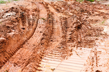 Bulldozer tracks in the dirt