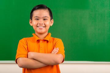 Cheerful Vietnamese schoolboy