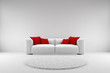 White couch with red pillows