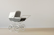 canvas print picture - Vintage baby buggy with copy space