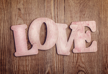 Wooden letters forming word LOVE