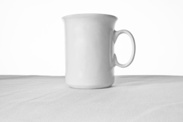 white cup on the white tablecloth