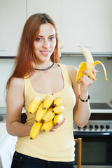 long-haired girl eating banana