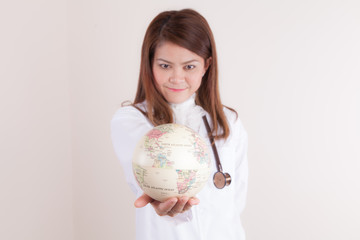 Asian Female doctor showing globe on her hand