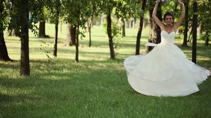Bride Spins Around With a Bouquet