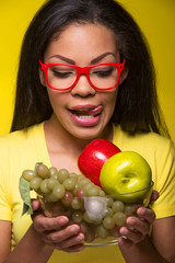 Closeup African AMerican woman with fruits.