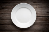 Empty white plate on wooden table - 68556184