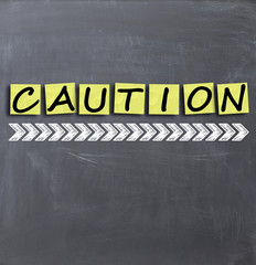 Caution text on blackboard