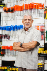 Confident Customer With Arms Crossed Hardware Shop