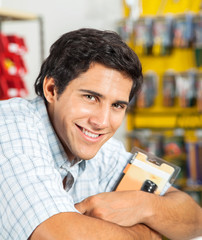 Man Smiling In Hardware Store