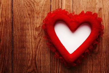 red heart on wood with copy space
