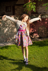 young girl stretching and dancing at yard