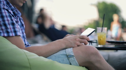 Man hands with tablet computer in outdoor bar