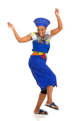 african woman in traditional clothes dancing