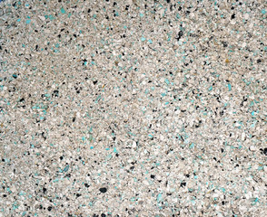 Background of small blue, gray, white and black small granules (