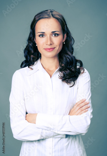 canvas print picture Smiling businesswoman, over gray