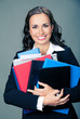 Businesswoman with folders, on gray