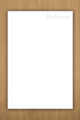 Blank book or magazine cover on wood background
