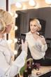Beautiful girl taking selfie in the mirror