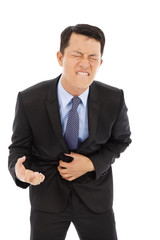 Businessman have stomach pain isolated on a white background