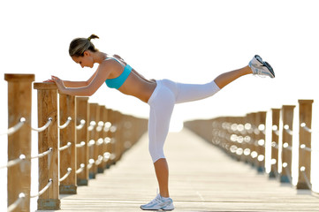 young woman exercising outdoor in summer morning