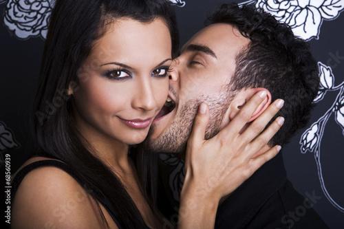Portrait of a handsome couple kissing
