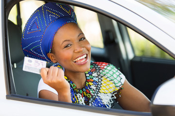 african woman showing her driver's license