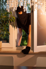 Burglar entering the house