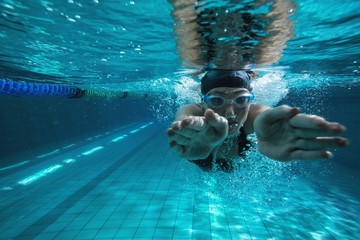 Athletic swimmer training on her own