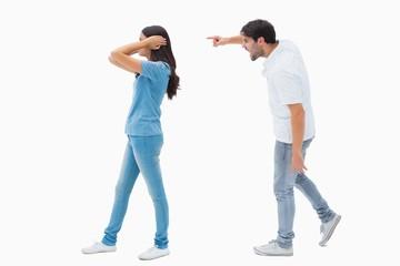 Angry boyfriend shouting at girlfriend