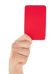 Hand holding red card up
