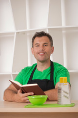 Funny man in apron cooking