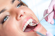 Dentist working on girls teeth - 68563732