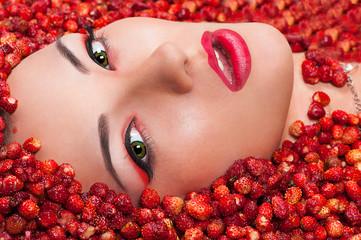 sensual beautiful female face in wild strawberry