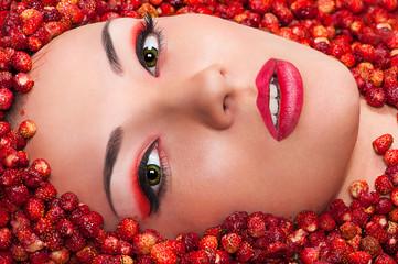 Beautiful female face in wild strawberry