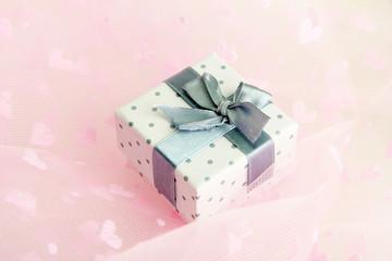 Beautiful romantic gift box on pink background