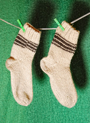 white wool socks on a clothesline