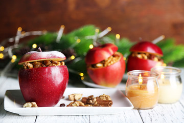 Stuffed Christmas apples with nuts and raisins