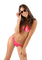 Beautiful young woman in pink swimsuit isolated on white