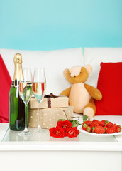 Romantic still life with champagne, strawberry and roses in