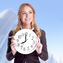 Happy businesswoman with big clock