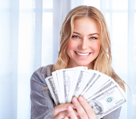 Happy woman with lot of money