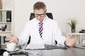 Medical Expert Reading Reports While Having Coffee