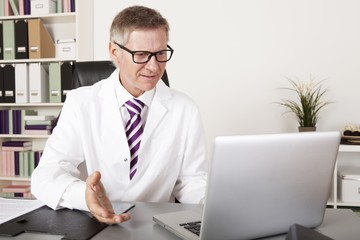 Health Professional Talking Client using Laptop