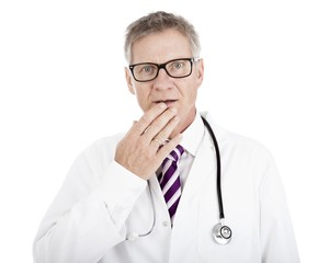White Doctor Touching his Lip While in Doubt