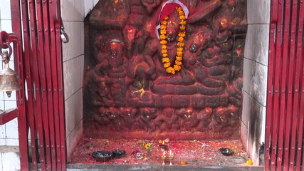 hinduism worship place altar with candles and bells